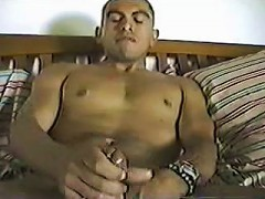 Naugthy gay in bed wanking happily